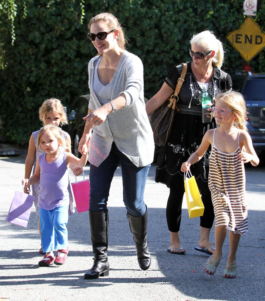 Pregnant Jennifer Garner heads to a party with daughters.