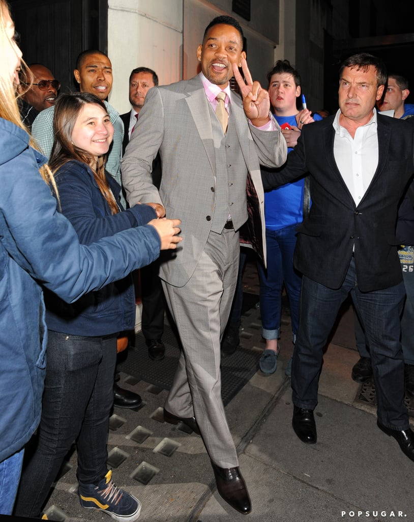 Will Smith greeted fans while leaving a restaurant.