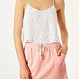We'd rock this Topshop lace crop camisole ($36) with high-waist jeans.