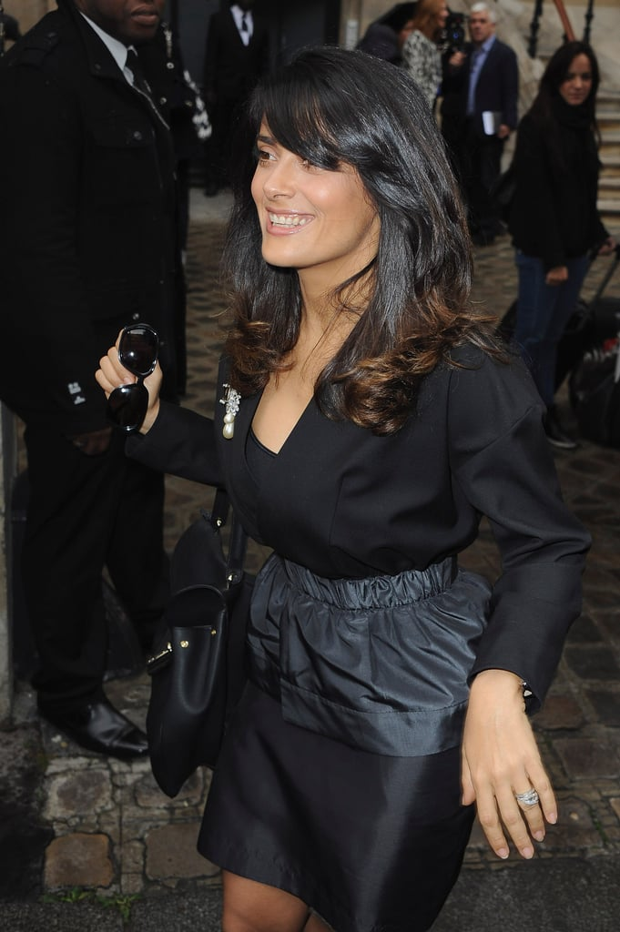 Salma Hayek sported a black and gray outfit.