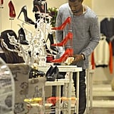 Kanye West checked out some red high heels.
