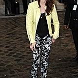Kristen Stewart wore a neon leather jacket and printed pants to Balenciaga's Fashion Week runway presentation in Paris.