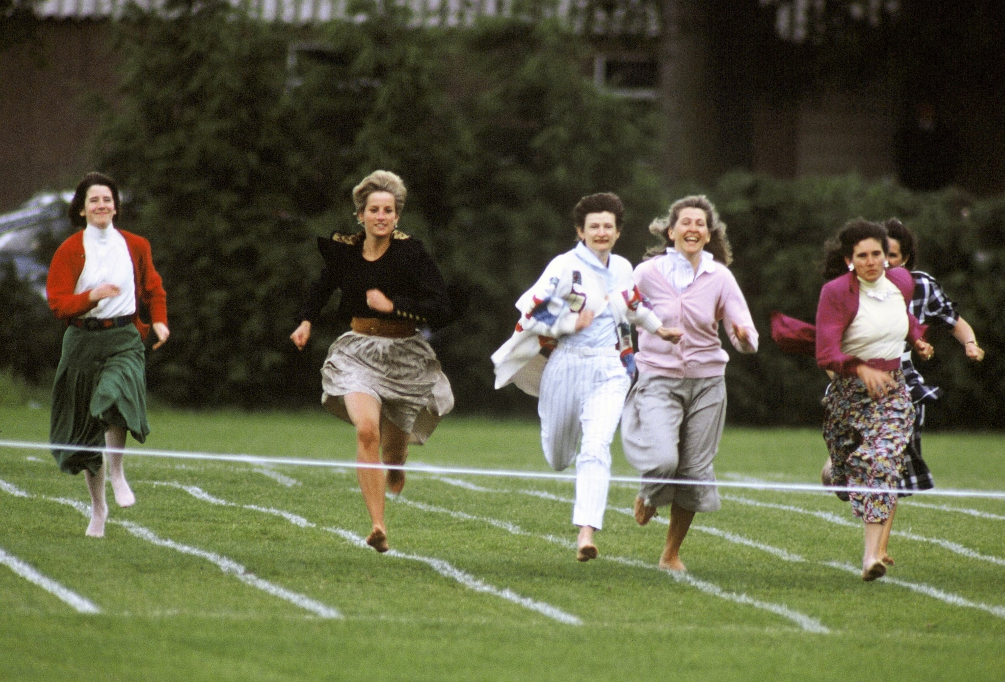 ENGLAND - 1991:  Princess Diana, Princess of Wales, running in the mothers race on school Sports day in 1991 in England.  (Photo by Anwar Hussein/WireImage)