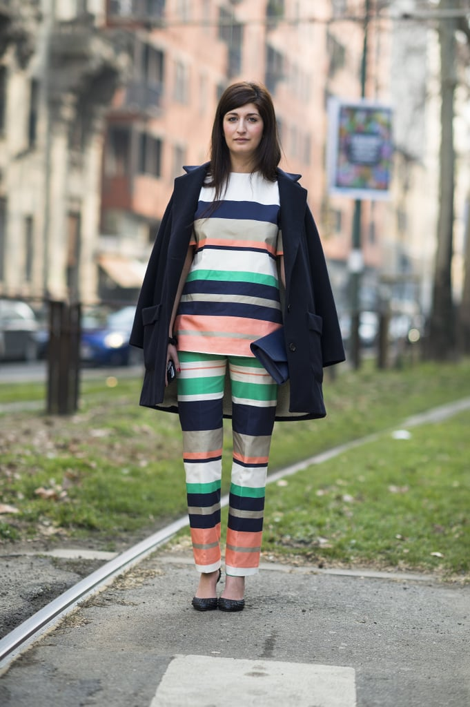 Sharp, multicolored stripes looked toward Spring, while this attendee's draped coat played to the weather at hand. Source: Le 21ème | Adam Katz Sinding