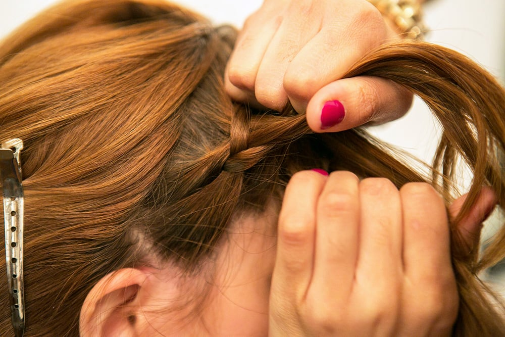 Continue to braid like a normal three-strand braid, adding in strands as you go along to create your woven headband. Source: Caroline Voagen Nelson