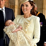 Kate Middleton left the christening with George in her arms.