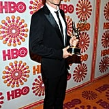 Supporting actor in a miniseries winner Guy Pearce posed with his Emmy on the red carpet at the HBO afterparty.
