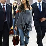 Victoria wore a pair of rolled-up jeans with a cozy poncho in the Shanghai airport in December 2004.