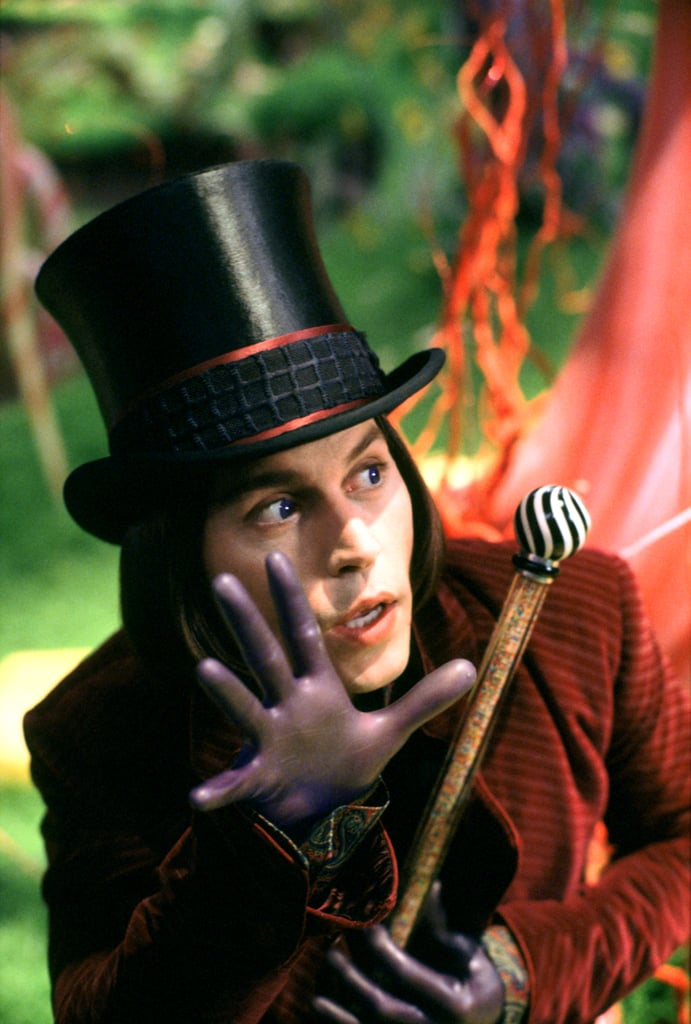 Oh, and we can't forget the plum-coloured gloves that fit so tightly, they're like a second skin. Meanwhile, his top hat is black instead of brown and has two stripes that match his coat.