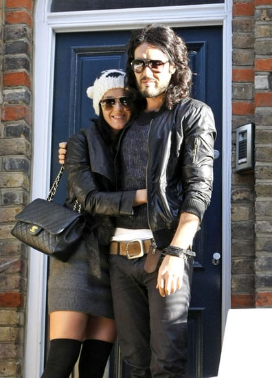 Russell Brand and Katy Perry pose for the  cameras in front of his house