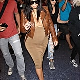 For a cohesive, cool airport look, Kim slipped into a tan skirt and top set, then offset the look with a cool moto jacket and heels in complementing shades of brown.