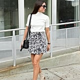 An Asymmetrical Skirt and Crisp Shirt With Leather Booties