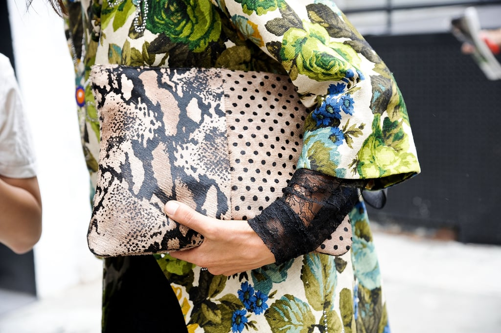 We love a little print juxtaposition, like florals and an exotic clutch.