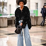 Wear Your Slashed Jeans With a Black Bucket Bag and Trainers Instead of Sandals and a Clutch