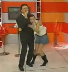 TV Host Gets Hair Stuck to Singer
