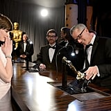 Anne Hathaway watched her best supporting actress Oscar statue get engraved at the Governors Ball.