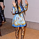 Wearing a matching Versace shirt and skirt with Balenciaga leopard-print over-the-knee boots.