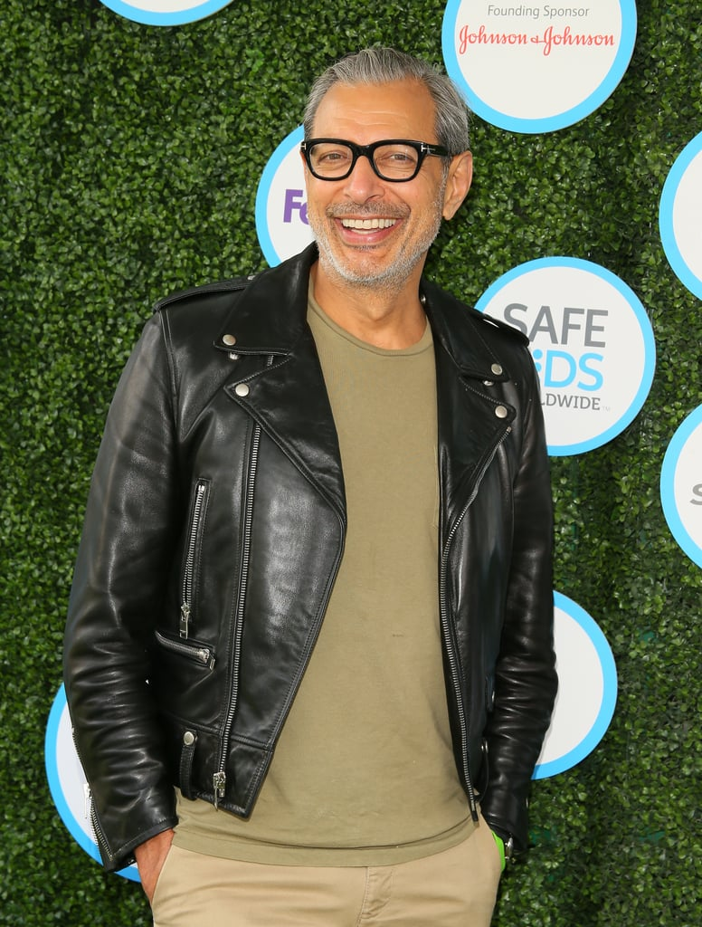 Jeff Goldblum can do it all: play dream husband to wife Emilie Livingston, fry up some damn good eggs, and pose with raptors like it's his day job. Which it technically is. Day jobs aside, we're convinced the Jurassic Park actor's true calling is wearing a leather jacket. And whether he's sporting one over a classic white tee, teaming it with a trilby, or opting for an all-black ensemble, the red-hot actor looks simply flawless.  If you're having one of those days — you know, the one where your oat milk is out of date, the hairspray can is empty, and you miss the bus — don't fret, we've got you covered. Simply inhale a large breath, breathe out slowly, and scroll through the following images.       Related:                                                                                                           Pardon This Interruption to Your Day, but Here Are 20 Sexy as Hell GIFs of Jeff Goldblum