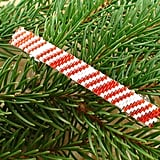 Indulge your sweet tooth without the threat of cavities with this adorable candy cane beaded barrette ($10).