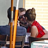 Miley Cyrus and Liam Hemsworth kissing.