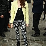 Kristen Stewart wore floral pants with black booties to attend Balenciaga's Paris Fashion Show.