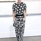 Katy Perry made a chic appearance at the Chanel Spring 2014 show wearing a black-and-white floral ensemble with cap-toe pumps.