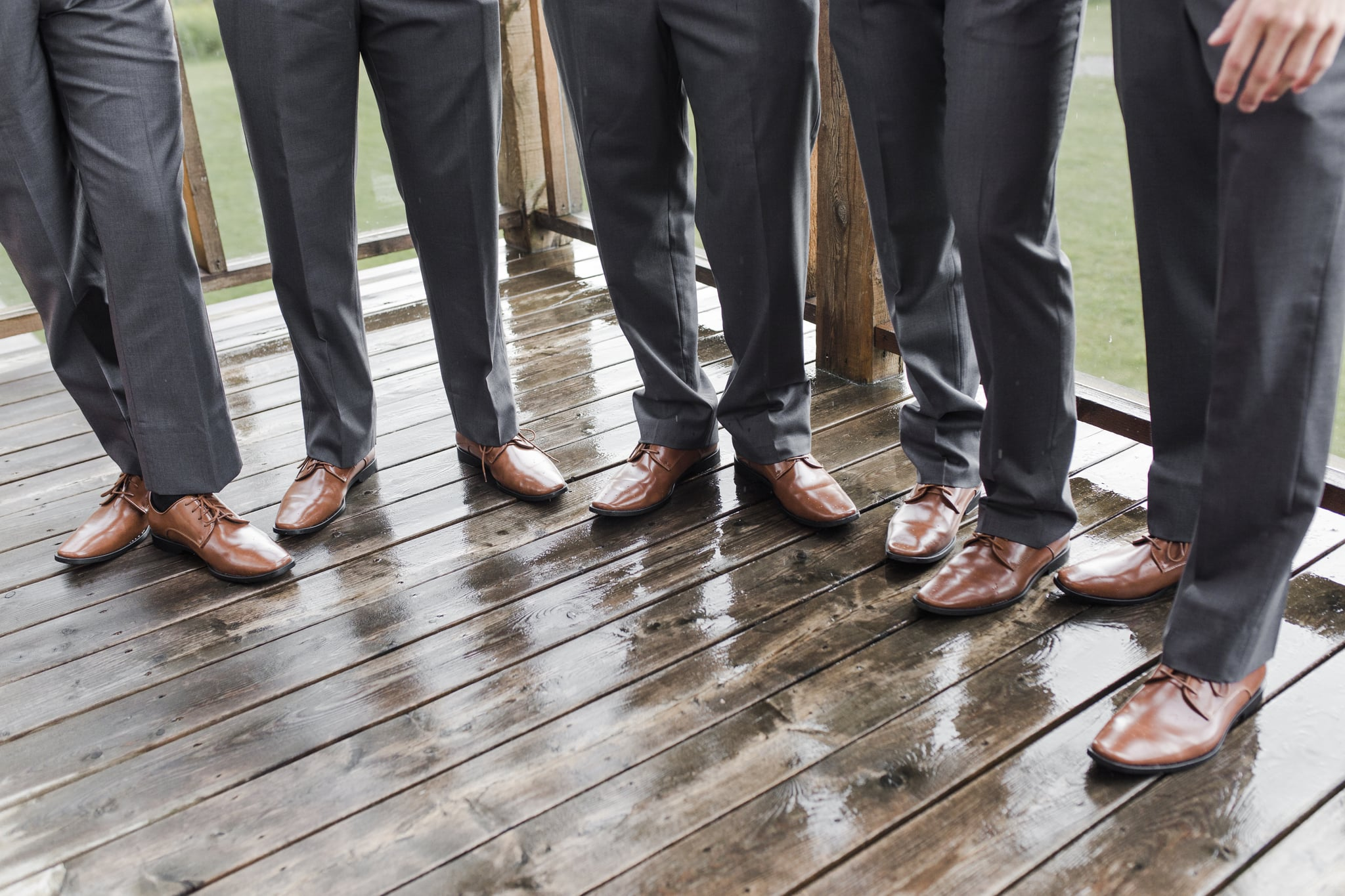 Groomsmen legs and shoes in a row
