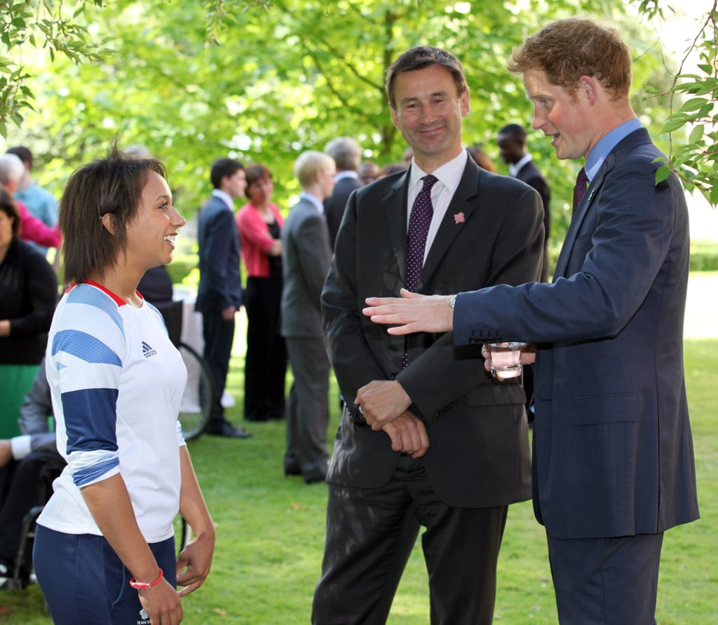 """Prince Harry showed his London Olympics pride with a lapel pin this morning at a special reception. He invited 25 young athletes to his father Prince Charles's official residence, Clarence House. The youngsters were selected to attend after they won their own gold medals at the First National Finals of the School Games, with which Harry is involved, in May. Along with UK Culture Secretary Jeremy Hunt, Prince Harry said a few words. Harry teased Jeremy about an incident last month, in which a bell Jeremy rang during an Olympics ceremony broke apart and nearly flew into a group of bystanders. Harry sought to inspire the 25 kids to think about the Rio 2016 games. He said, """"Because of your achievements, you have become role models — not just for your friends at school but for the next generation of British athletes. I urge you to pick up the torch — or, in Jeremy's case, the bell — and I expect to see your faces again when you stand on the podium at Rio and beyond."""""""
