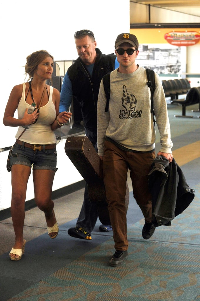 Robert Pattinson is a traveling man with a new favorite sweatshirt. The actor headed to Berlin today ahead of tomorrow's Water For Elephants premiere in the city. He's kicking off his international press duties, though leading lady Reese has yet to join him abroad. Robert has barely had a free moment between his WFE promotional push and wrapping up Breaking Dawn — he spent the weekend in the Caribbean with Kristen Stewart, taking care of a few reshoots for the Twilight honeymoon scene. Robert's hard work has been paying off, since despite coming in third overall at the box office, Water For Elephants exceeded expectations and scored the highest opening weekend for a drama this year. At least some of his official duties involve spending time with his girl, and their island weekend meant a bikini and shirtless makeout session after Robert and Kristen's kiss made sparks fly last week.