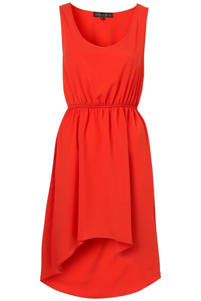 This red-orange, asymmetrical hem dress is the perfect colorful canvas for dressing up with a cool belt or statement necklace.  Topshop Dip Hem Dress ($76)