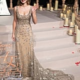 When Emma hit the red carpet at the Shanghai premiere, she slipped out of her shawl to show off the gown's intricate train and accessorized with Repossi jewels.