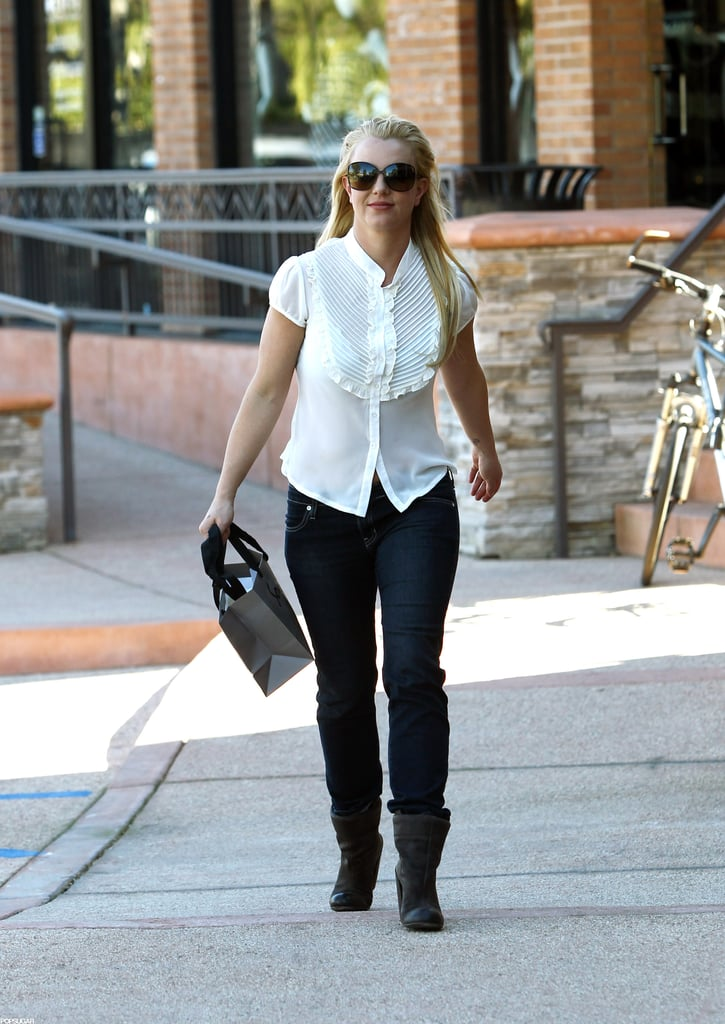 Britney Spears kicked off the week with a little beauty maintenance and shopping in LA yesterday. The singer kept it casual in a sheer white blouse, jeans, and a pair of boots as she stopped into Forever Bella for a tan, then picked up a small bag's worth of items from Sogno boutique.  Britney has kept to a low-key routine since announcing her breakup from fiancé Jason Trawick earlier this month. The news followed shortly after she also confirmed her departure from The X Factor. No replacement has been revealed for Britney's seat, but she may have already found a new gig since rumors are circling that she'll wind up headlining in Vegas. News broke last week that Britney was offered a $100 million deal for a two-year contract at Caesars Palace.