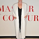 Stella McCartney topped her black party look with a minimalist white coat.