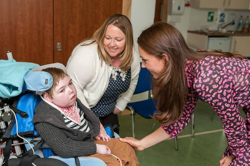 "Kate Middleton made a second solo outing this week on Thursday, visiting Treehouse Hospice for the UK's Children's Hospice Week. Just one day after learning about her grandmother's history and Morse code at Bletchley Park, the Duchess of Cambridge wore a pink paisley-printed Diane von Furstenberg dress as she visited with sick children and some of the hospice's staff in Ipswitch, England. After seeing children at Treehouse, Kate released a heartfelt statement about the impact her visits have on her.  ""Around the clock support is crucial for children receiving palliative care. They and their families often need help every hour of every day, both in hospices and at home. As Patron of EACH, I have seen first-hand this remarkable and varied work and just how vital the support of staff and volunteers can be to the families of children with life-limiting conditions. It has been wonderful to see the fantastic public support for Children's Hospice Week over the last few days. Please continue supporting your local children's hospice in whatever way you can."" Kate has been the East Anglia's Children's Hospices organization's royal patron since January 2012, and this isn't her first visit with sick children this year. During the royal tour in April, she went to the Rainbow Place Children's Hospice in New Zealand, bonding with kids and families during play and art therapy.  Source: Facebook user EACH Hospices"