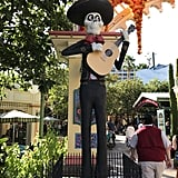 The entrance is flanked by a Catrina mariachi on one side . . .
