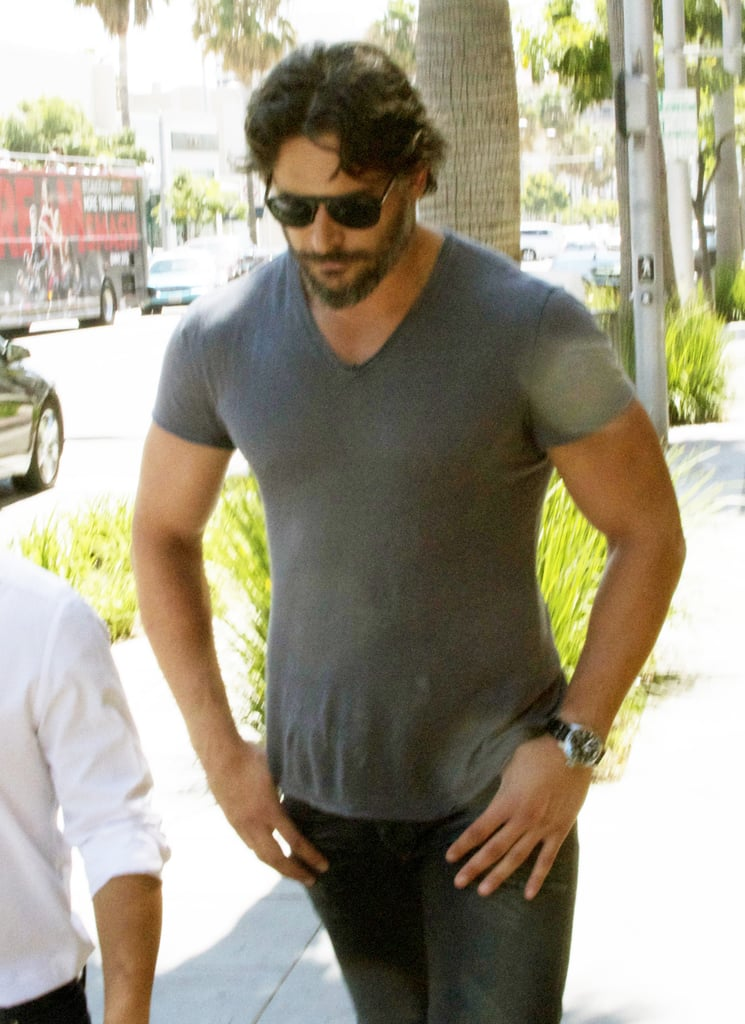 Joe Manganiello hung out with a friend in LA yesterday. Joe is enjoying some free time after wrapping up another season of his hit show. True Blood's season 5  ended with an appropriately bloody finale on Sunday night. Joe's on a break from his werewolf ways, but he's taken on another small-screen gig. Joe will make appearances in two new episodes of How I Met Your Mother. Joe is also currently competing for the number one spot in our shirtless bracket. The competition ends tomorrow so cast your vote now if you want to help Joe take the crown.