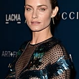 With skin as stunning as Amber Valletta's, the barely there makeup look is easy to pull off. However, she did add a pale pink shadow to keep the look from getting too boring.