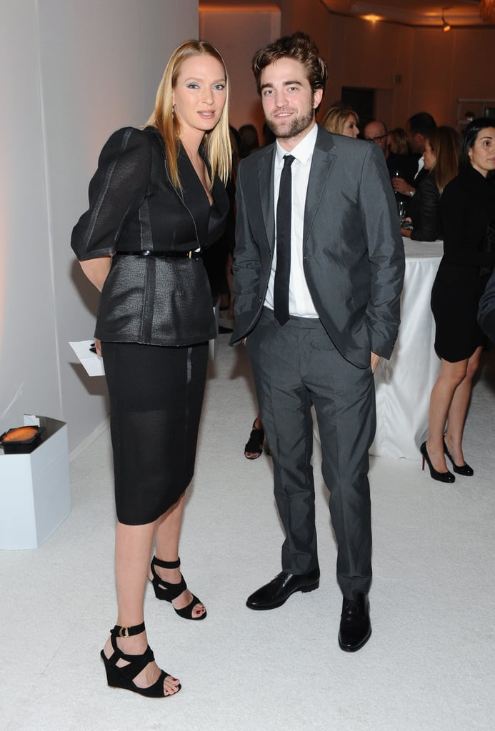 Robert Pattinson posed for photos with Uma Thurman at the Elle Women in Hollywood Awards in LA.