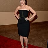 Piper Perabo sported a dark hair color and black dress for the event.