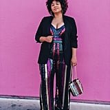 A Festive Sequined Jumpsuit Under a Blazer Styled With Hoops