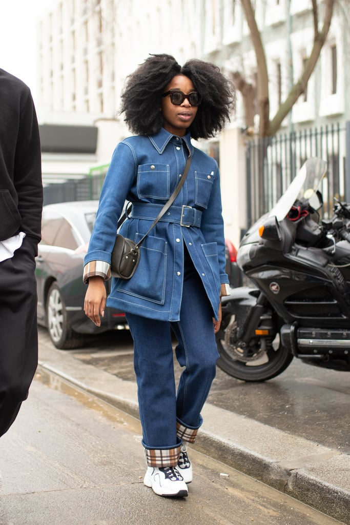 Tailored yet sporty, a belted jean jacket looks fresh with wide-leg jeans and sneakers.