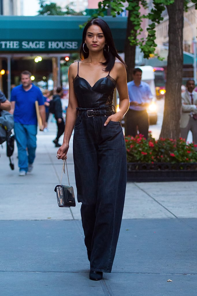 Shanina Shaik styled her leather and lace corset top with a pair of high-waisted baggy jeans.