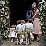 Kate returned the favor for her younger sister by keeping the pageboys and flower girls in line.