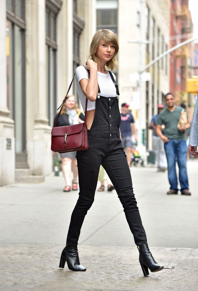 She paired the black, button-front piece with a white crop top, black booties, and a cranberry-colored satchel.