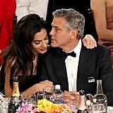 Amal Alamuddin cuddled up to George Clooney.