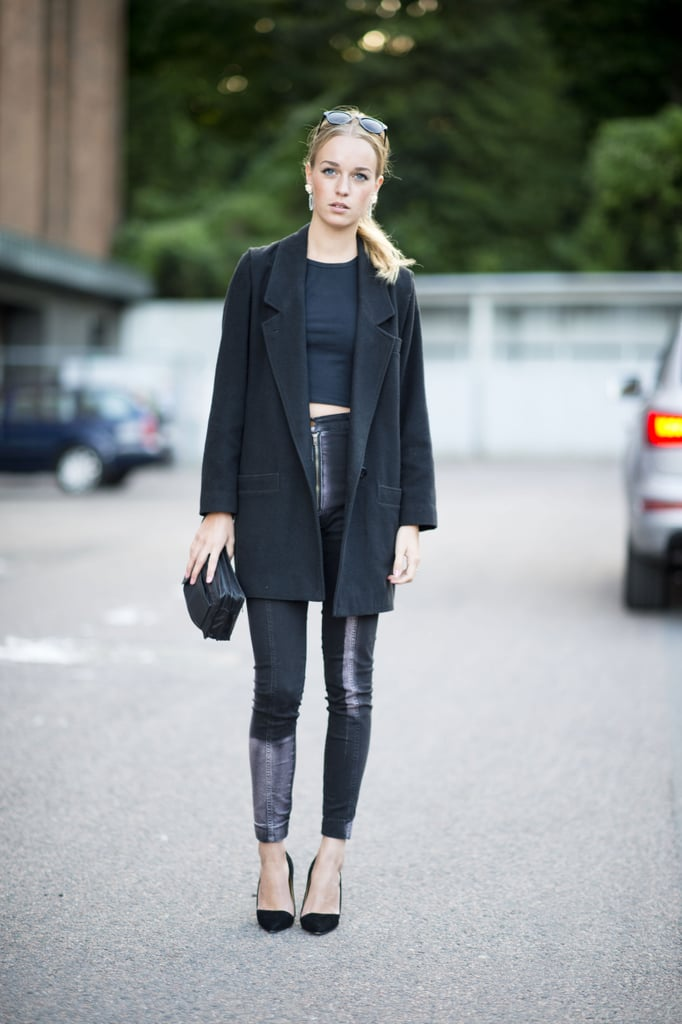 All-black feels extra cool with leather accents and a crop top (just remember to do as she does and cover up with a blazer or coat in the chill). Source: Adam Katz Sinding