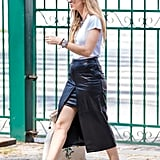 A leather pencil skirt goes from sleek to sporty with sneakers.