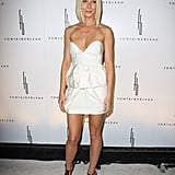 Gwyneth showcased her fit frame in a strapless Stella McCartney mini and Ferragamo cutouts in Miami.