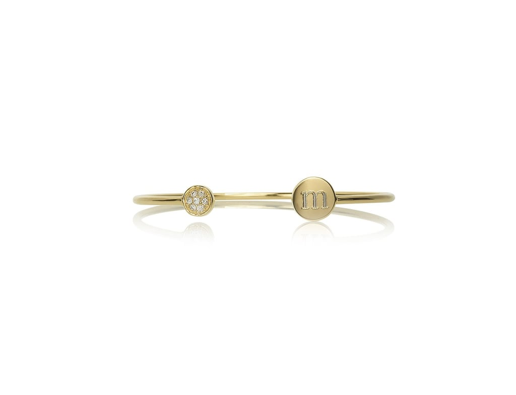 Sarah Chloe monogram bangle ($379), made exclusively for Goop, is a winner. And anything personalized gets an extra vote from us! — Kim Timlick, director of POPSUGAR international