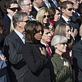 Michelle Obama held her hand over her heart during the ceremony.
